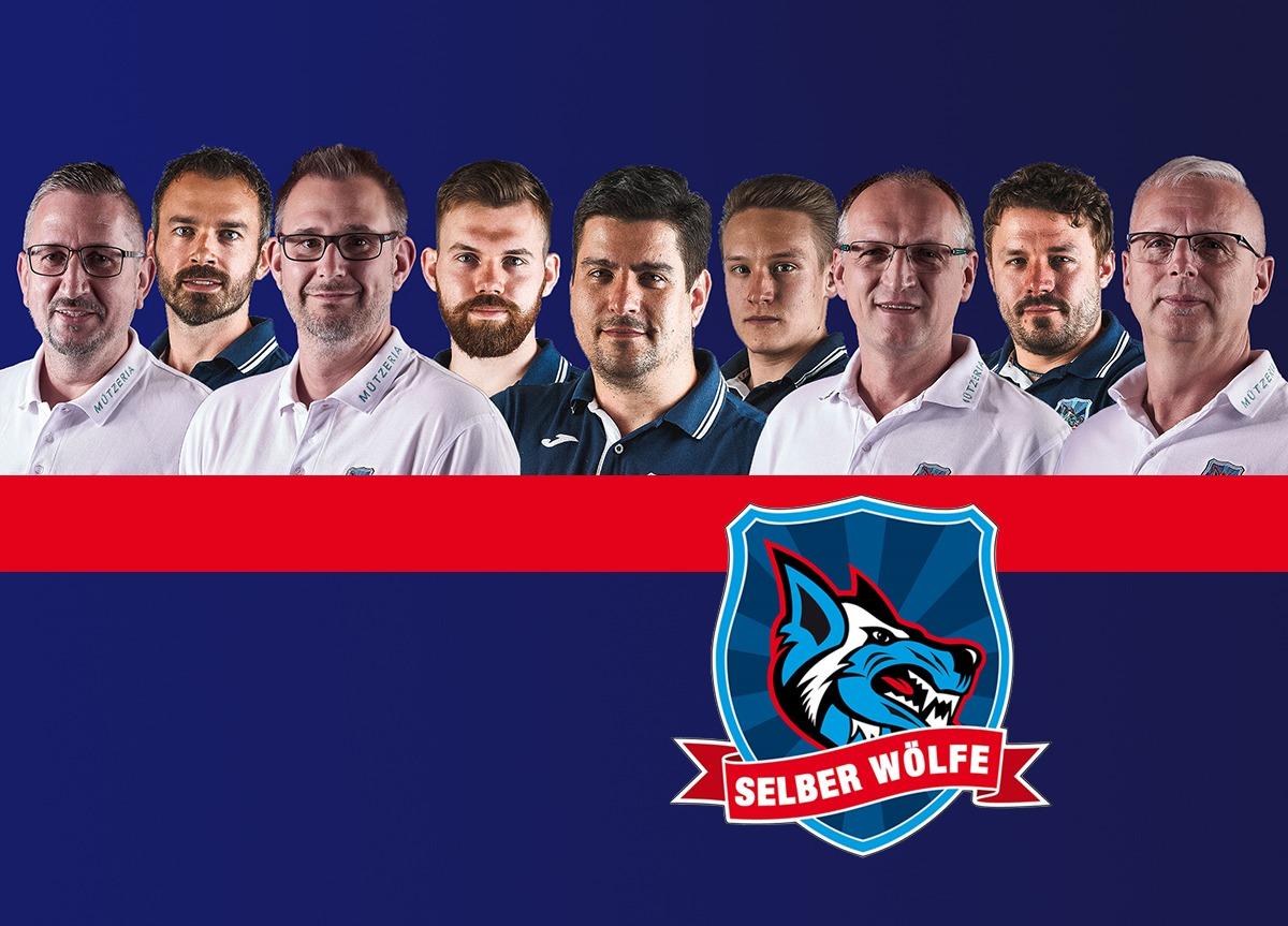Das Wölfe-Off-Ice-Team Steht